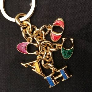 Coach- Gold with multicolored letters key fob